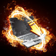 Laptop computer on fire — Stock Photo