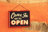 Come in - we are open — Stock Photo