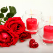 Roses and candles — Stok fotoğraf