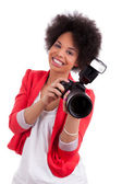 Young african american photographer with camera — Stock Photo