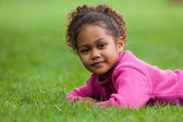 Portrait of a Adorable little African Asian girl lying down on — Stock Photo