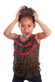 Little African Asian girl holding her head — Stock Photo