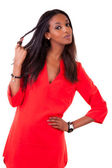Beautiful young black woman in red dress — Stock Photo