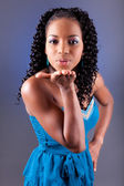 Young beautiful african american woman blowing a kiss — Stock Photo