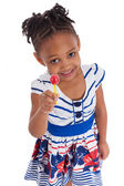 Portrait of a cute little african american girl with a lollipop — Stock Photo