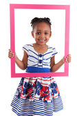Little african american girl holding a picture frame — Stock Photo