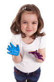 Little caucasian girl with hands painted — Stock Photo