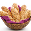 Whole wheat breads in basket — Stock Photo