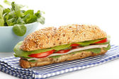 Footlong ham & swiss submarine sandwich on white background — Stock Photo