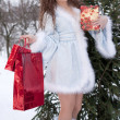 Snow Maiden with gifts — Stock Photo
