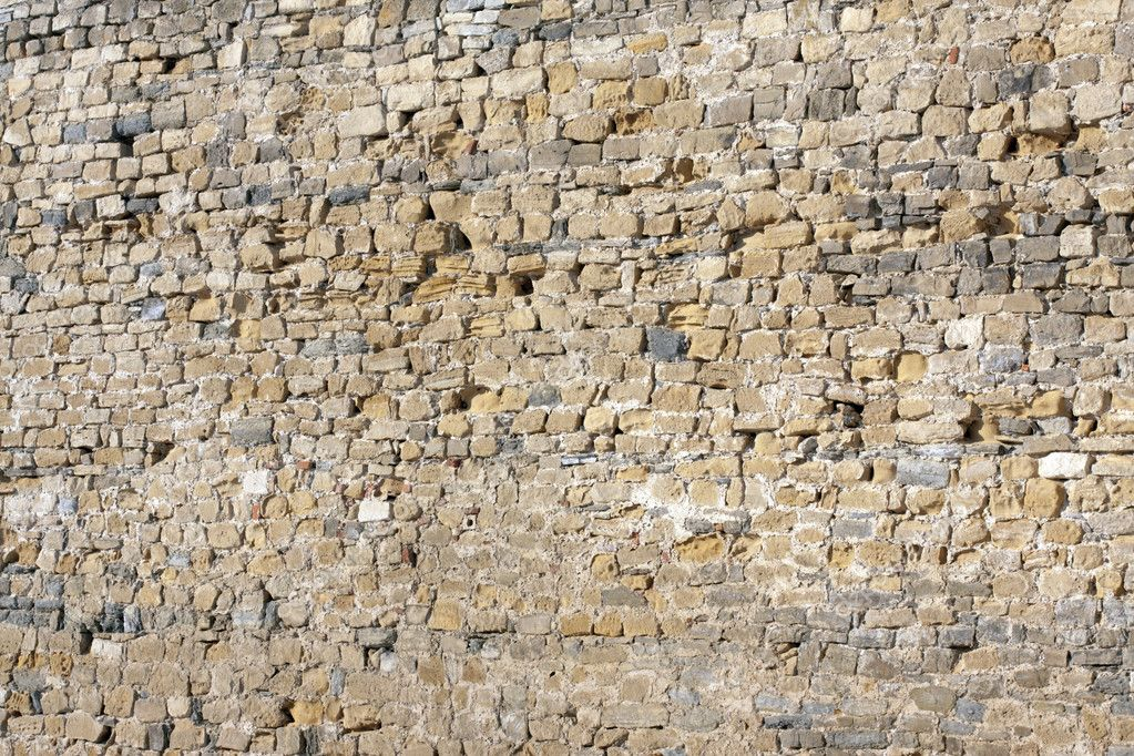 An old stone wall consisting of parts of the stone — Stock Photo #8842555