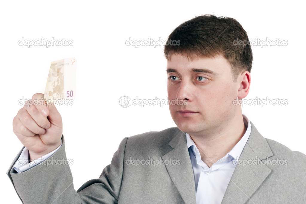 Man on a white background is considering the money  Stock Photo #9283790
