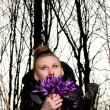 Stock Photo: Girl with snowdrops