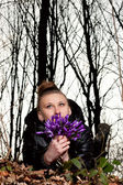 Girl with snowdrops — Stock Photo