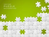 Vector fondo verde hecha de pedazos de rompecabezas blanco — Vector de stock