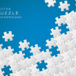 Vector blue background made from white puzzle pieces — Stock Vector #10582866