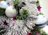 Christmas tree with decorations and shiny balls — Stock Photo