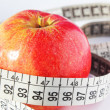 Royalty-Free Stock Photo: Red fresh apple and measure tape. diet concept
