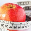 Red fresh apple and measure tape. diet concept — Stock Photo #8741683