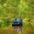 SUV in river — Stock Photo #8328942
