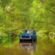 SUV in river — Stock Photo