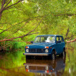 SUV in river — Stock Photo