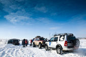 SUVs on snow — Stock Photo