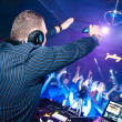 DJ shoots video on mobile phone - Stock Photo