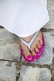 Pink flip-flop footwear — Stock Photo