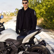 Man with a motorcycle — Stock Photo #8986264