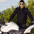 Man with a motorcycle — Stock Photo #8986407
