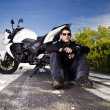 Man with a motorcycle — Stock Photo #8986451
