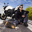Man with a motorcycle — Stock Photo #8986462