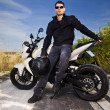 Man with a motorcycle — Stock Photo #8986559