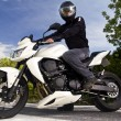 Man with a motorcycle — Stock Photo #8986633