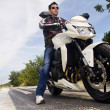 Man with a motorcycle — Stockfoto