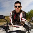 Man with a motorcycle — Stock Photo #8986853
