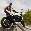 Man with a motorcycle — Stock Photo #8987010