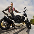 Man with a motorcycle — Stock Photo #8987020