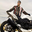 Man with a motorcycle — Stock Photo #8987033