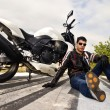 Man with a motorcycle — Stock Photo #8987045