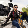 Man with a motorcycle — Stock Photo #8987055