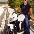 Man with a motorcycle — Stock Photo #8987191