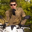 Man with a motorcycle — Stock Photo