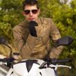 Stock Photo: Man with a motorcycle