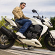 Man with a motorcycle — Stock Photo #8987401