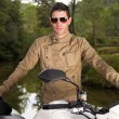 Man with a motorcycle — Stock Photo #8987493