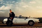 Man with white convertible — Stock Photo