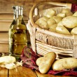Still life of potatoes in a basket - Stock Photo