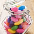 Colorful jelly beans in bottle - very shallow depth of field — Stock Photo #10271407